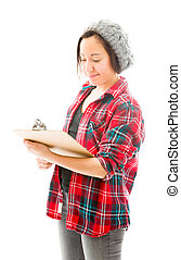 Young woman writing on clipboard isolated on white background
