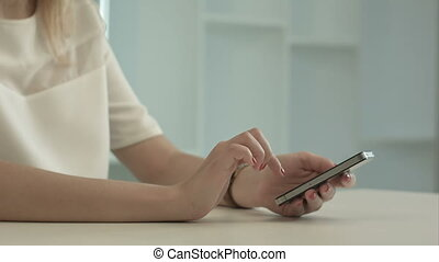 Young woman writing sms message on mobile phone