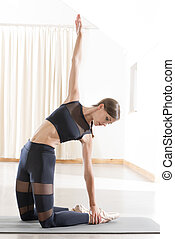 Young Woman Yoga Lower Body Stretching - Young woman yoga ...