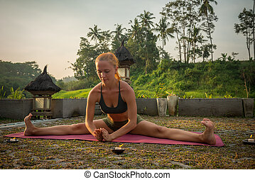 Young woman yoga stretching - Young woman performing yoga...