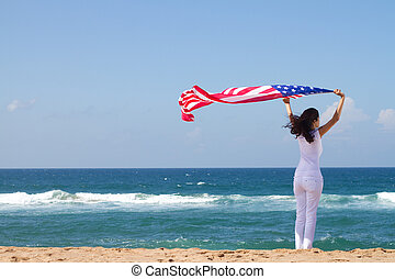 young womans american dream - woman holding american flag on...