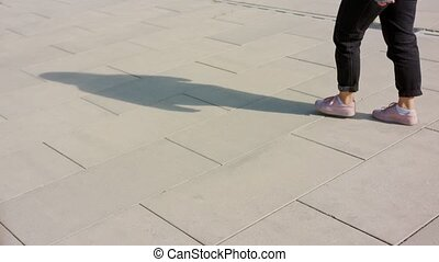 Young Woman's Feet Walking Outside - A young woman's feet...