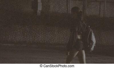 Young woman's self defense at night