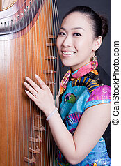 young women and Chinese zither