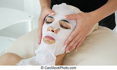 Young women at the cosmetology procedures