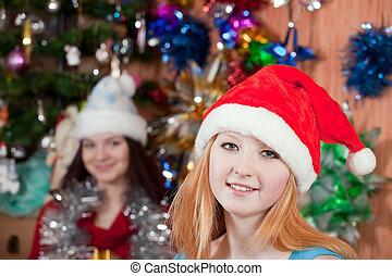 Young women celebrating Christmas