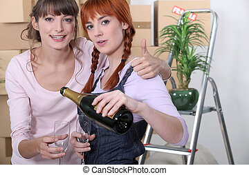 Young women celebrating on moving day