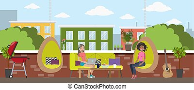 Young women chill out in the office break room