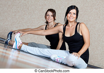 Young  women doing fitness exercises
