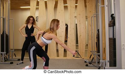 Young women doing fitness in the gym