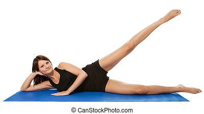 Young women doing legs stretching