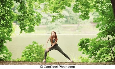 Young women doing yoga exercise standing
