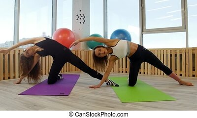 Young women doing yoga in the gym