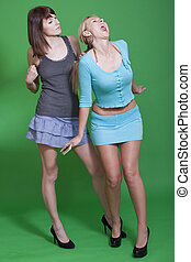 young women fighting - two young women fighting on green...