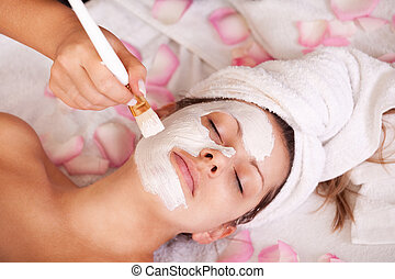 Young women getting facial mask. Spa studio shot