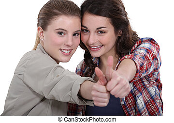 Young women giving the thumb's up