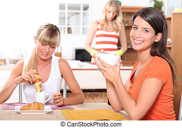 Young women having breakfast at home