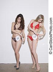 Young Women in Bikini Contest - Two young women...