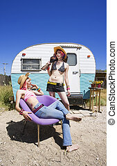 Young Women in Front of a Trailer
