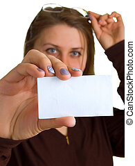 young women in glasses shows empty white card