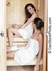 Young women in the sauna