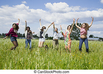 Young women jumping with joy