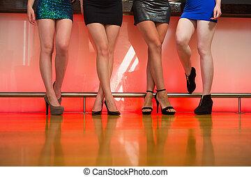 Young women legs posing