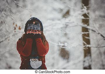 Young women outdoor enjoying the snow