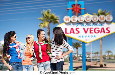 young women over welcome to las vegas sign