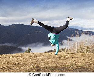 Young women performing cartwheel
