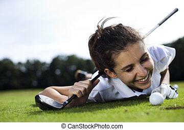 Young women playing golf