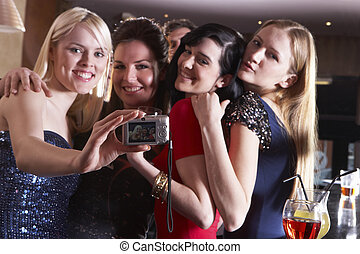 Young women posing at party