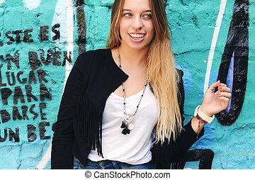 Young women posing outdoors
