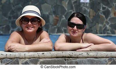 young women relaxing in a swimming
