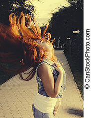 Young women shake her hand with long beautiful red hair