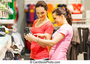young women shopping for sports shoes