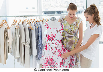 Young women shopping in clothes store