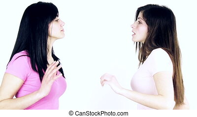 Young women shouting at each other fighting slow motion medium shot isolated