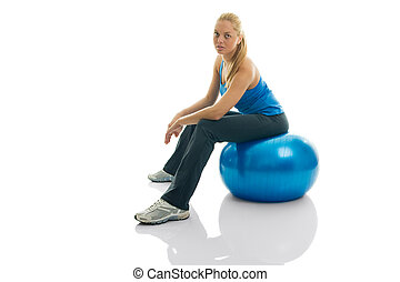 Young women sitting on fitness ball
