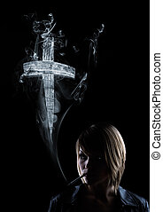 young women smokes, in the smoke appears a cross