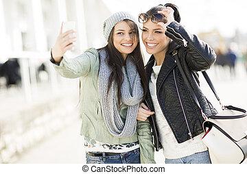 Young women takin selfie outdoor