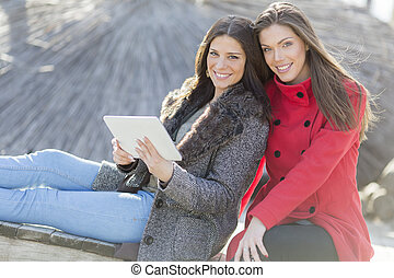 Young women taking a photo with mobile phone