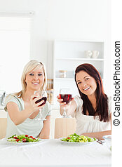 Young Women toasting with wine
