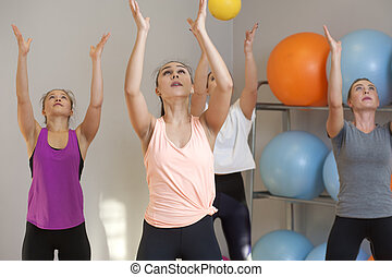 Young women training in fitness class