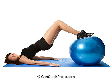 Reverse leg roll excercise - Young women training on a ...
