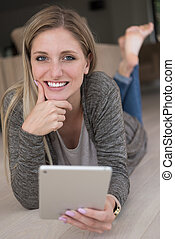 young women used tablet computer on the floor