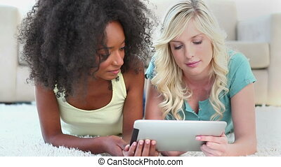 Young women using an ebook