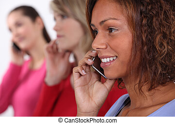 Young women using cellphones
