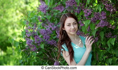 young women walking outside in a park lilac tree