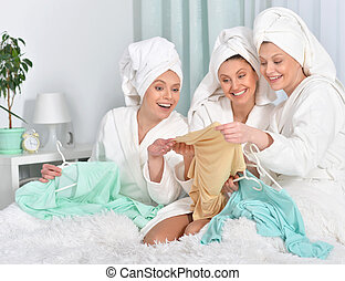 young women wearing a white bathrobes